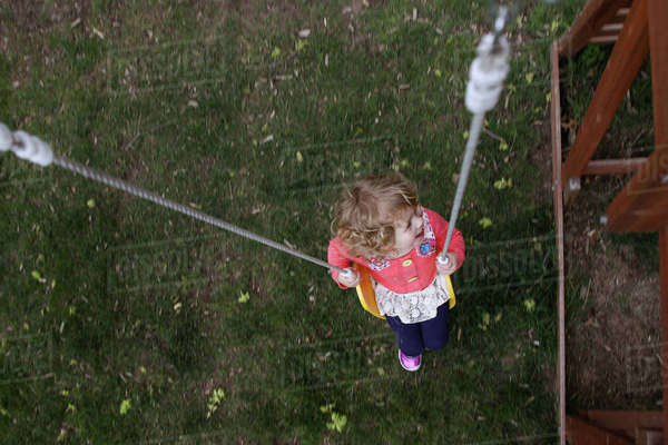 High angle view of girl swinging at yard Royalty-free stock photo