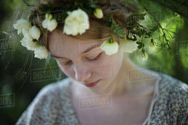 Close-up of thoughtful woman wearing tiara at park Royalty-free stock photo