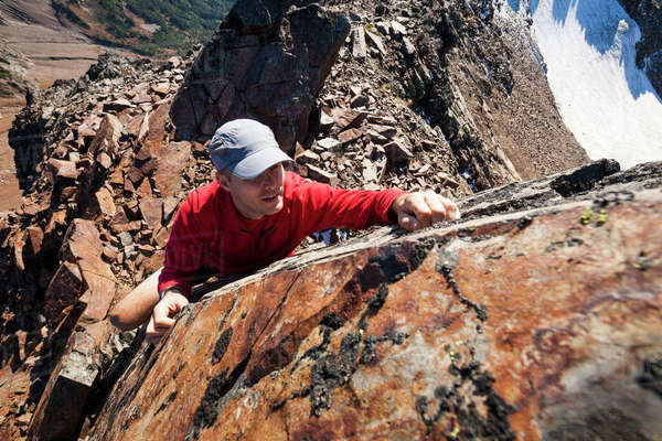 High angle view of hiker climbing rocky mountains Royalty-free stock photo