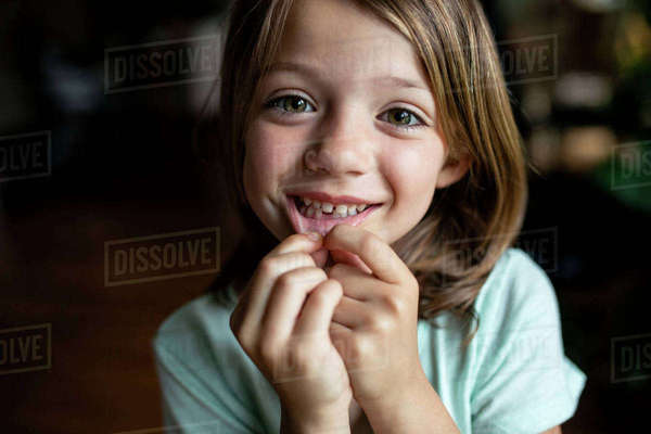 Portrait of happy girl showing tooth gap at home Royalty-free stock photo
