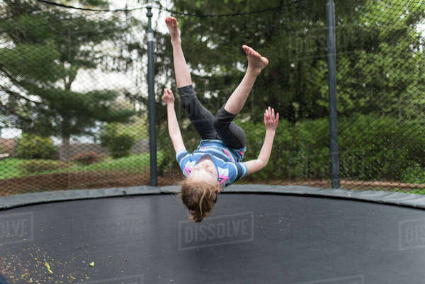 Playful girl jumping on trampoline at park Royalty-free stock photo