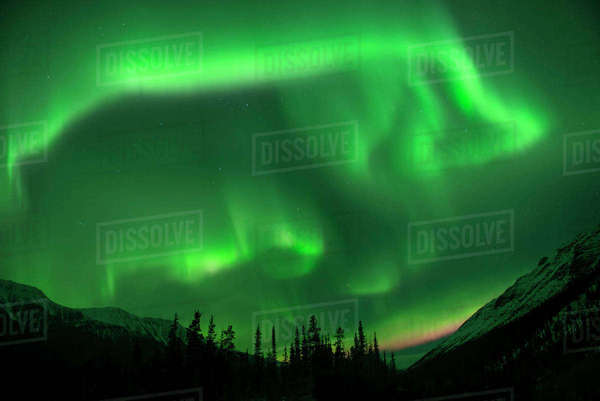 Idyllic view of mountains against aurora borealis at Northern Rocky Mountains Provincial Park Royalty-free stock photo