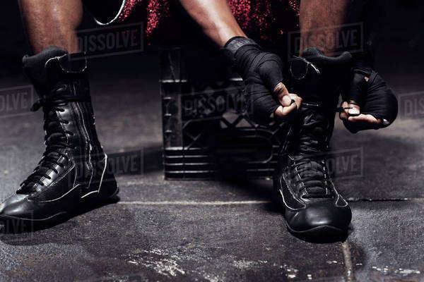 Boxer tying boots Royalty-free stock photo