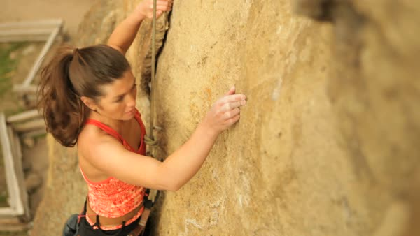 High angle handheld shot of woman climbing rock Royalty-free stock video
