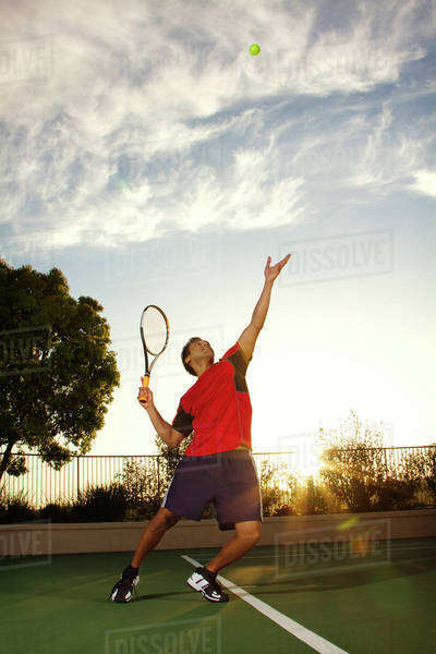 Young Man Throwing Tennis Ball Up For Serve Royalty-free stock photo