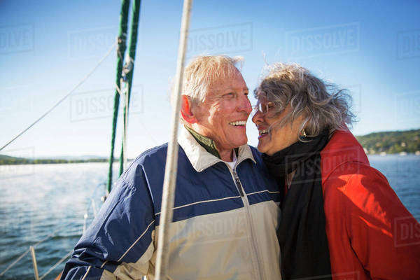 Smiling senior couple on sailboat Royalty-free stock photo
