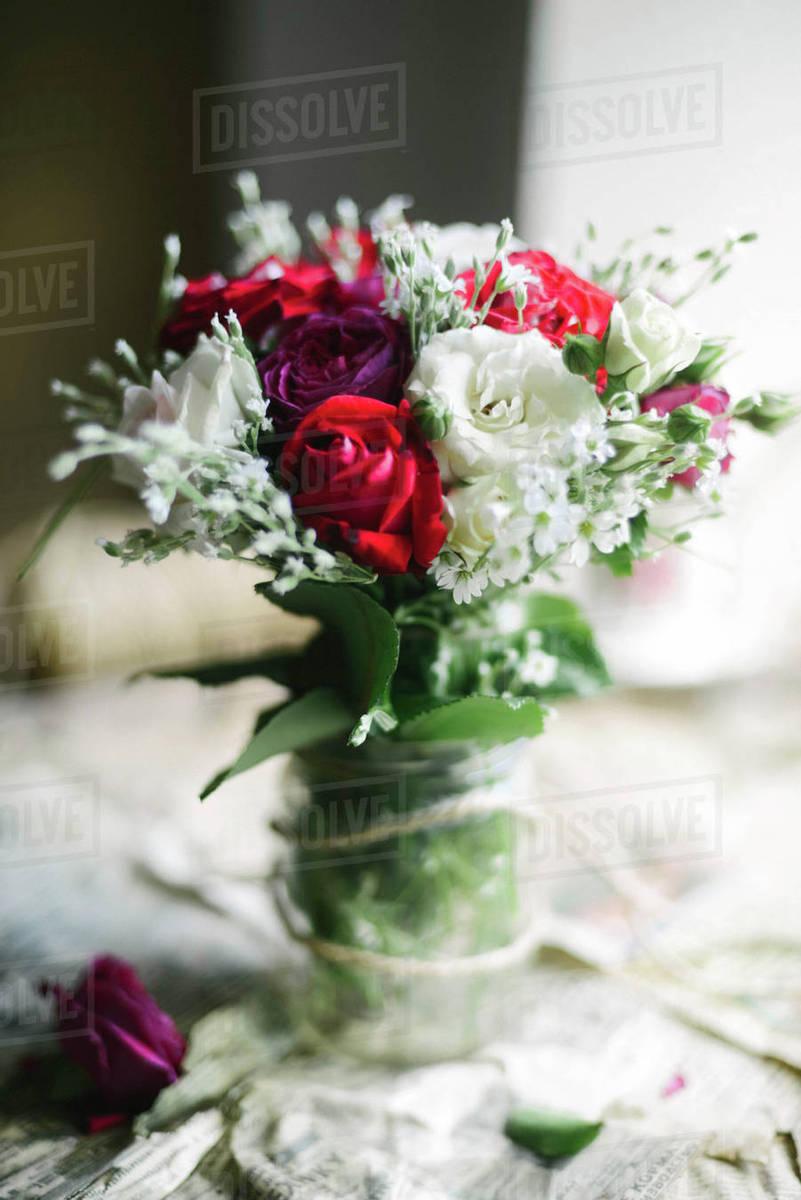 Bunch of flowers in jar on newspaper stock photo dissolve bunch of flowers in jar on newspaper izmirmasajfo