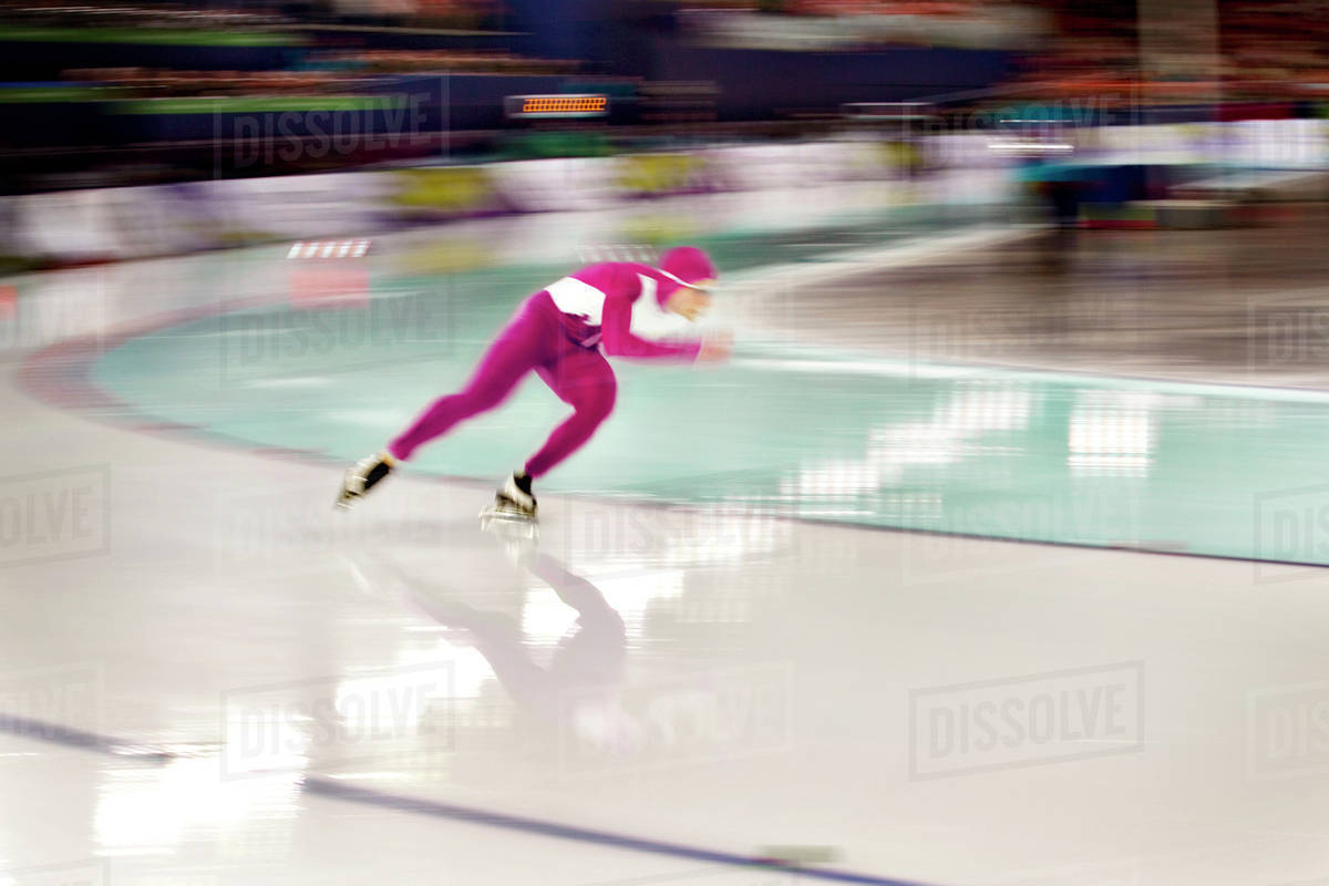 Speed skater rounding track curve Royalty-free stock photo