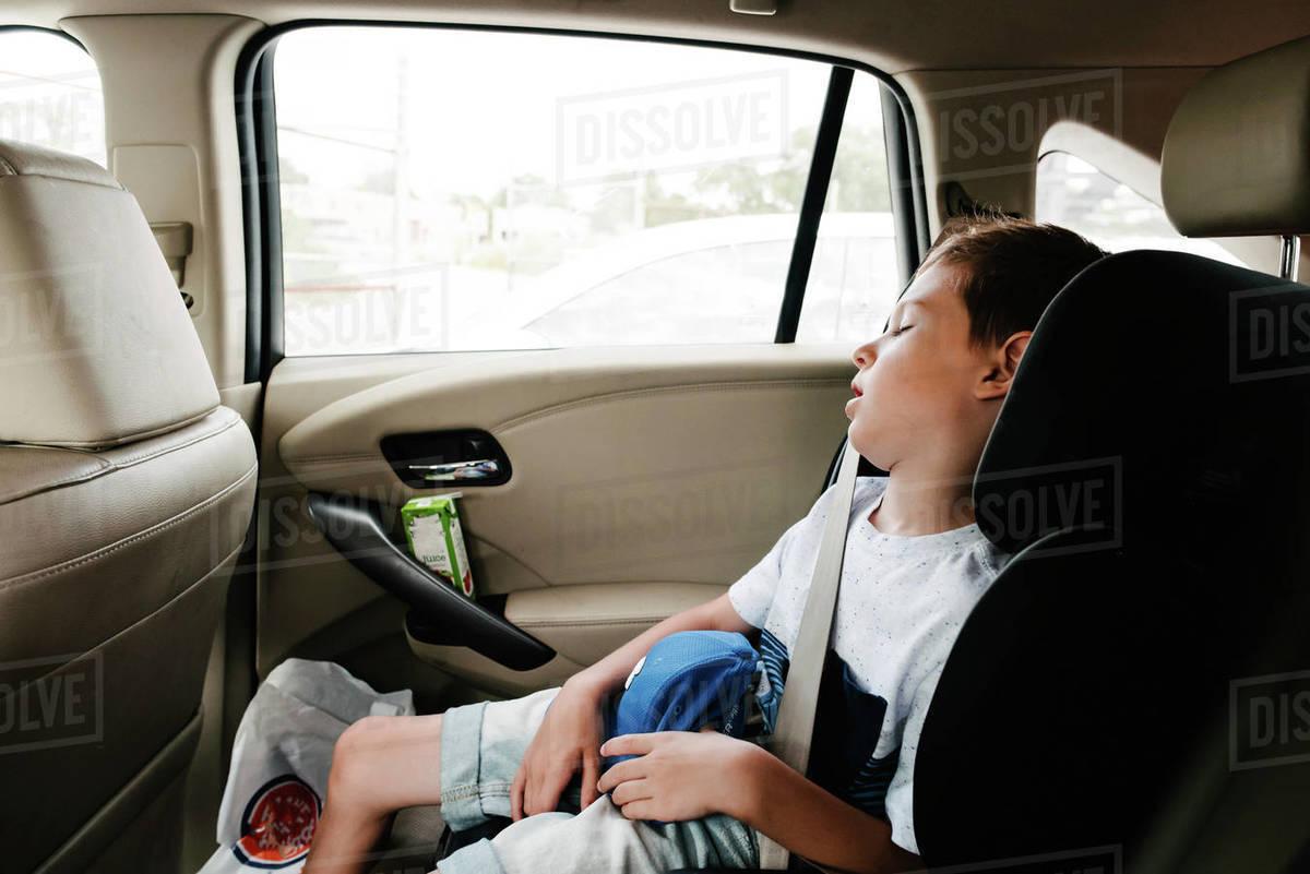 Sleeping In Car >> Boy Sleeping In Car Stock Photo Dissolve