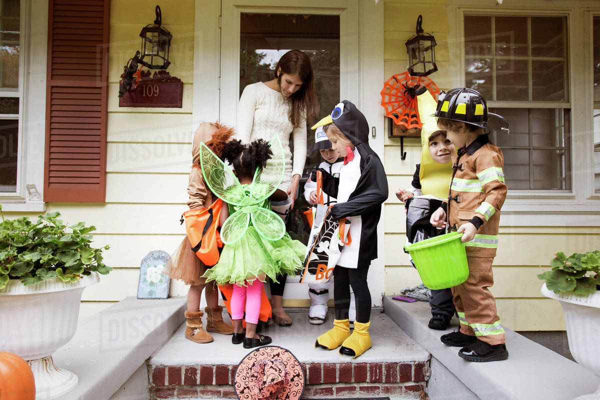 Children (2-3, 4-5) collecting sweets on halloween Royalty-free stock photo