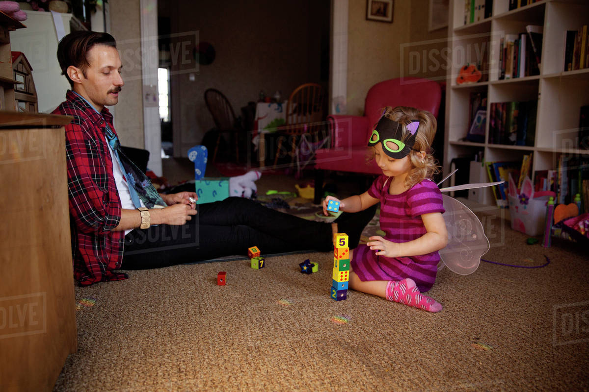 Father playing with daughter (2-3) wearing fairy costume Royalty-free stock photo