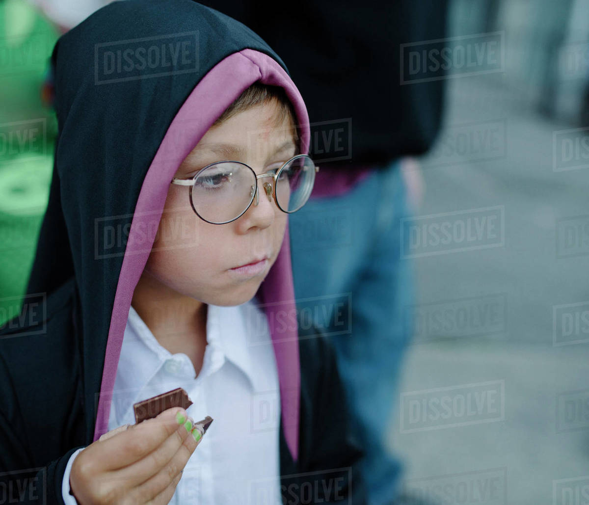Boy dressed up  holding chocolate while looking away during Halloween Royalty-free stock photo