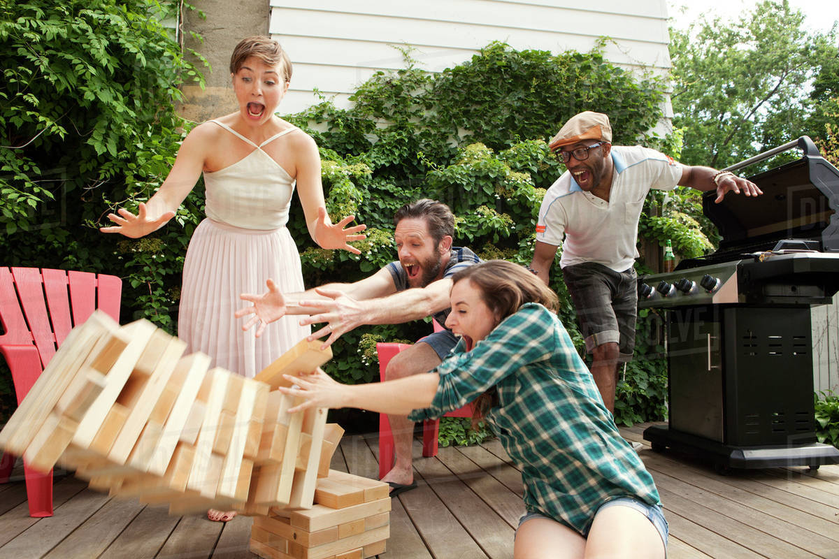 People playing jenga in backyard Royalty-free stock photo