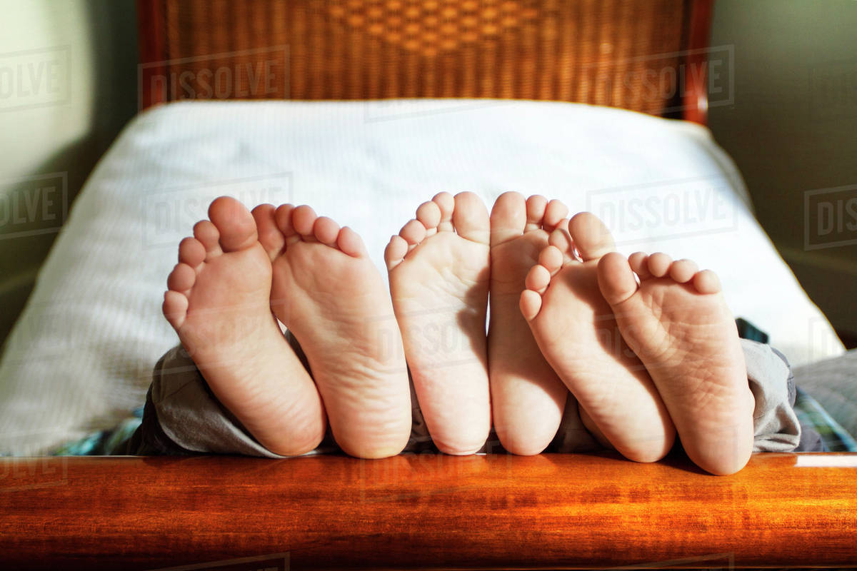 Boys Feet On Bed Frame