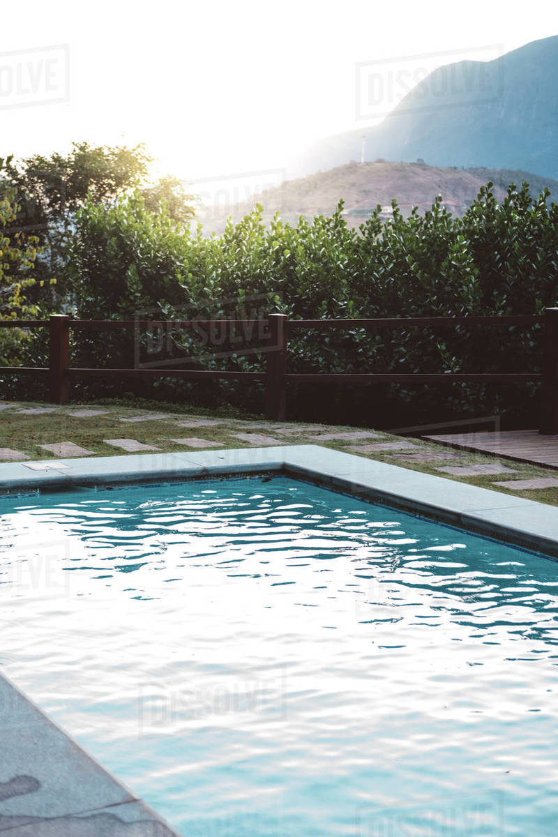Swimming Pool By Plants Against Clear Sky During Sunset Stock
