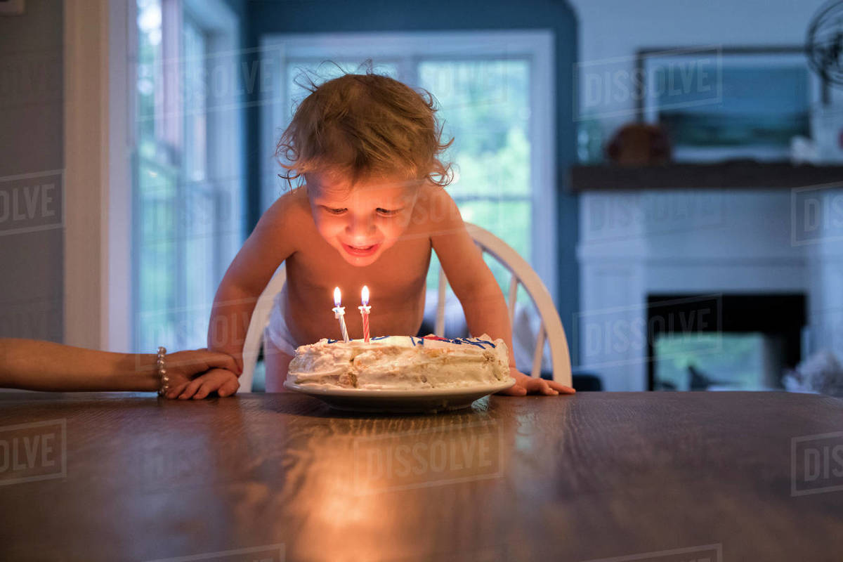 Marvelous Candlelit Toddler Boy Blowing Out Candles On Birthday Cake Stock Personalised Birthday Cards Sponlily Jamesorg