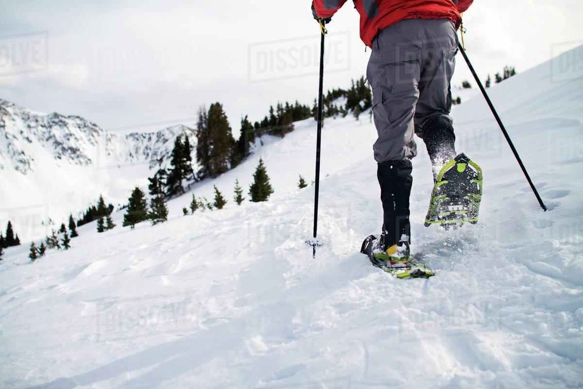 Man snowshoeing on mountain Royalty-free stock photo