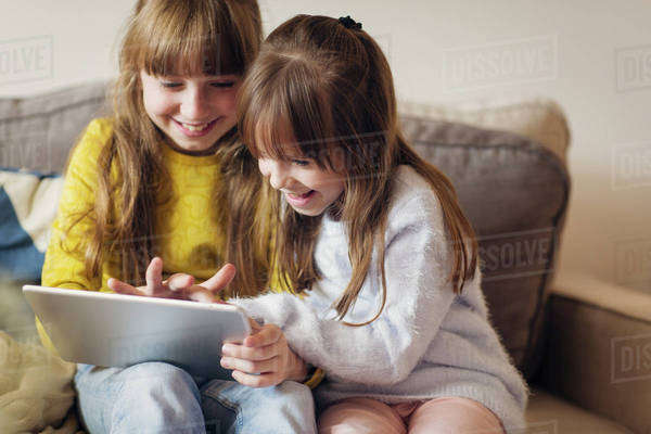 Two girls using digital tablet Royalty-free stock photo