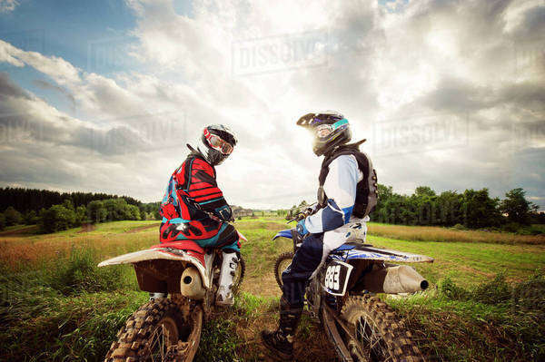 Two motocross riders looking back Royalty-free stock photo