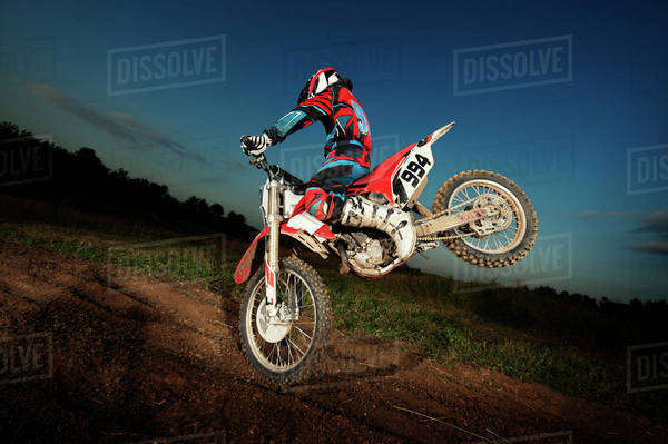 Motocross rider jumping on motorcycle Royalty-free stock photo