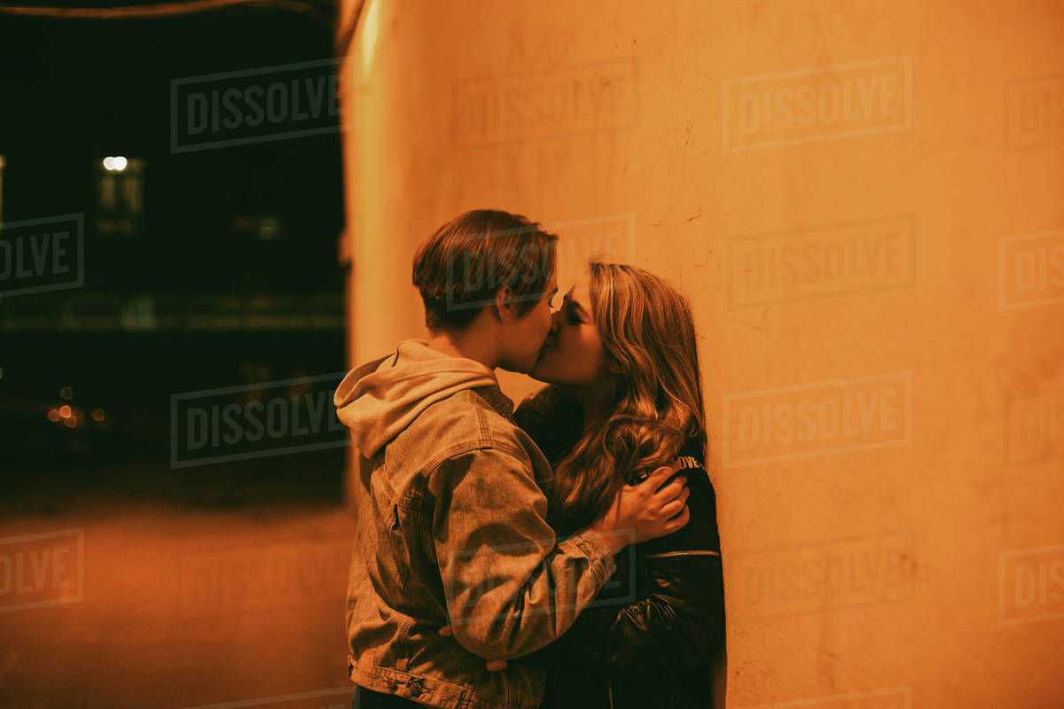 Free teen lesbian sex while standing Lesbian Couple Kissing While Standing By The Wall In City At Night Stock Photo Dissolve