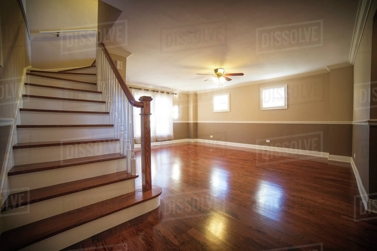 Empty living room with staircase and wood floors Royalty-free stock photo