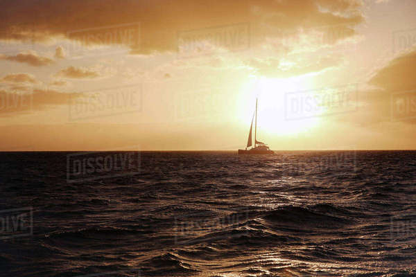 Boat sailing in sea against sky during sunset Royalty-free stock photo