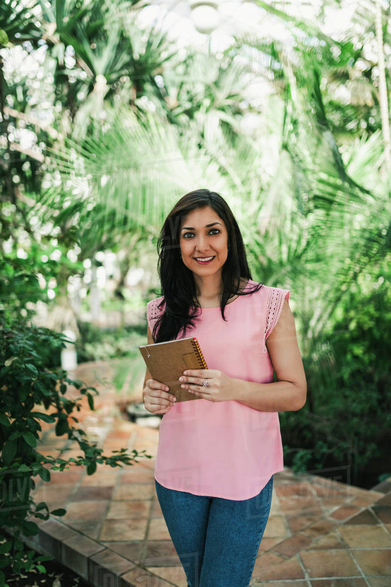 Corporate portrait of a beautiful agronomical engineer in a greenhouse Royalty-free stock photo