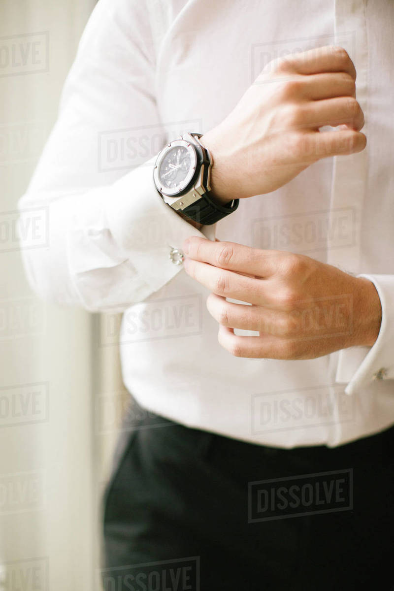 Groom's wristwatch and cufflinks. Suit. Royalty-free stock photo