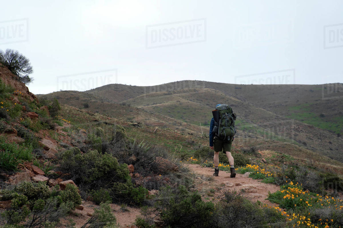 Man walks a rugged trail in the Superstition Mountains of Arizona Royalty-free stock photo