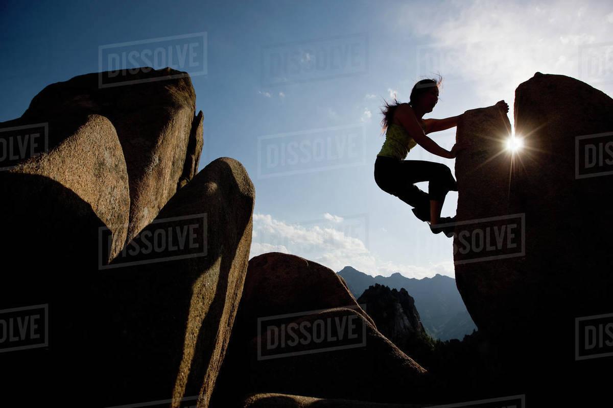 Female climber bouldering at Seroksan national park in South Korea Royalty-free stock photo