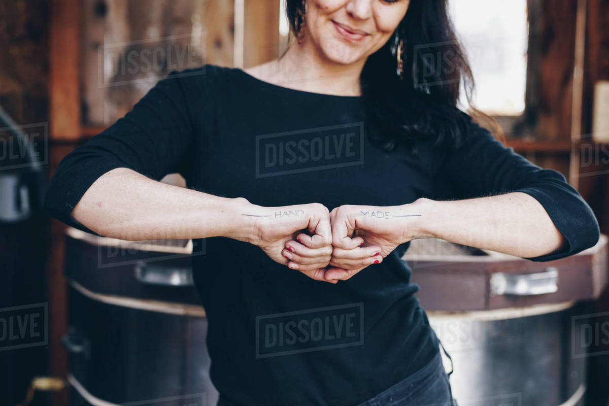 Artist shows off her tattoos, hand made, a tribute to the woman maker Royalty-free stock photo