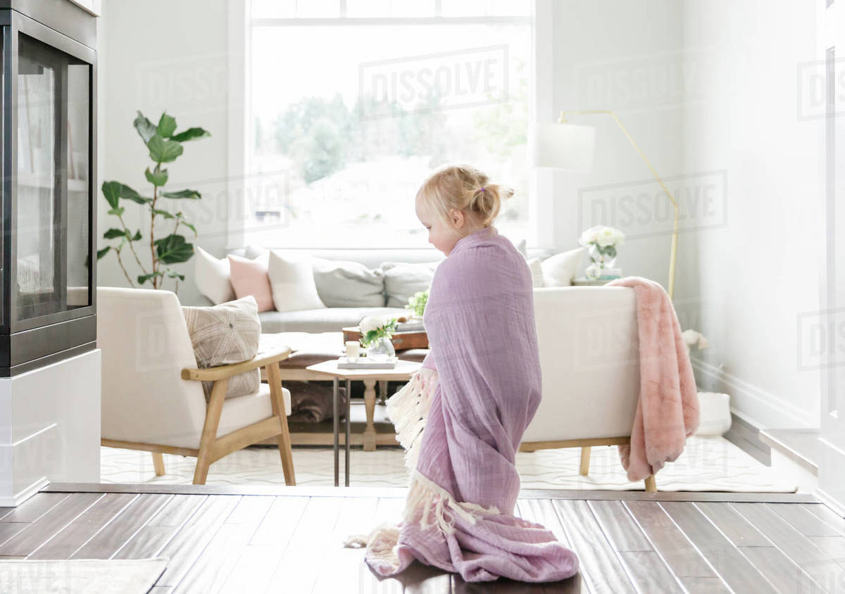 Blonde toddler girl in bright white house Royalty-free stock photo