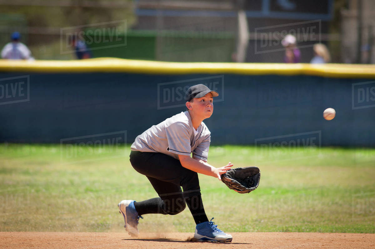 Little League infielder about to catch a baseball Royalty-free stock photo