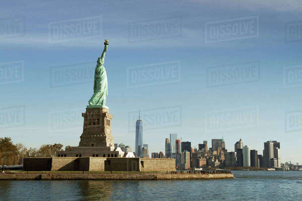 Statue of Liberty in city against sky Royalty-free stock photo