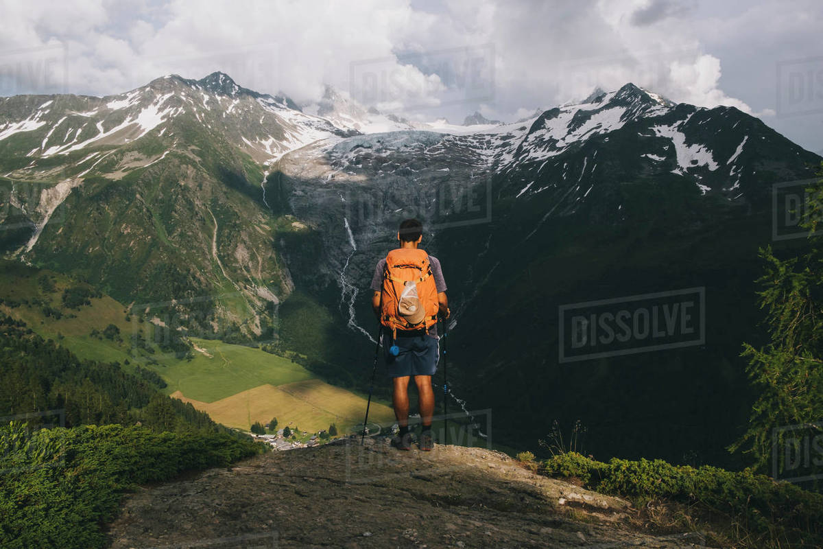 Man hiker standing on a hilltop in the French Alps, Le Tour, France Royalty-free stock photo