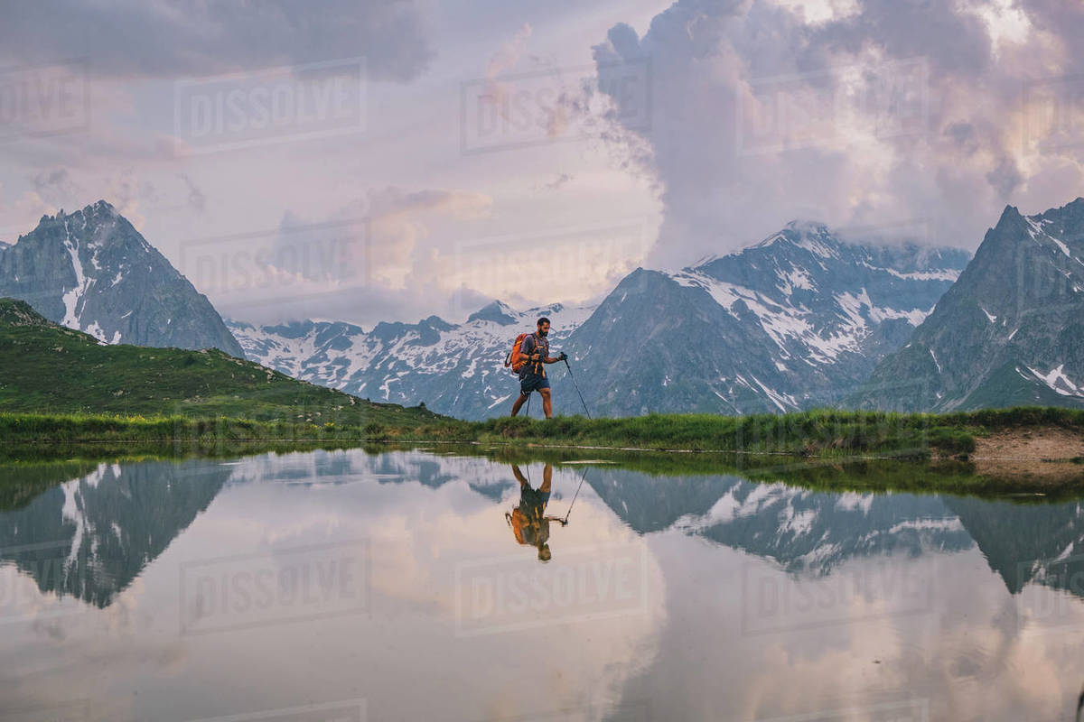 Young male hiking through at the French Alps, Chamonix, France. Royalty-free stock photo
