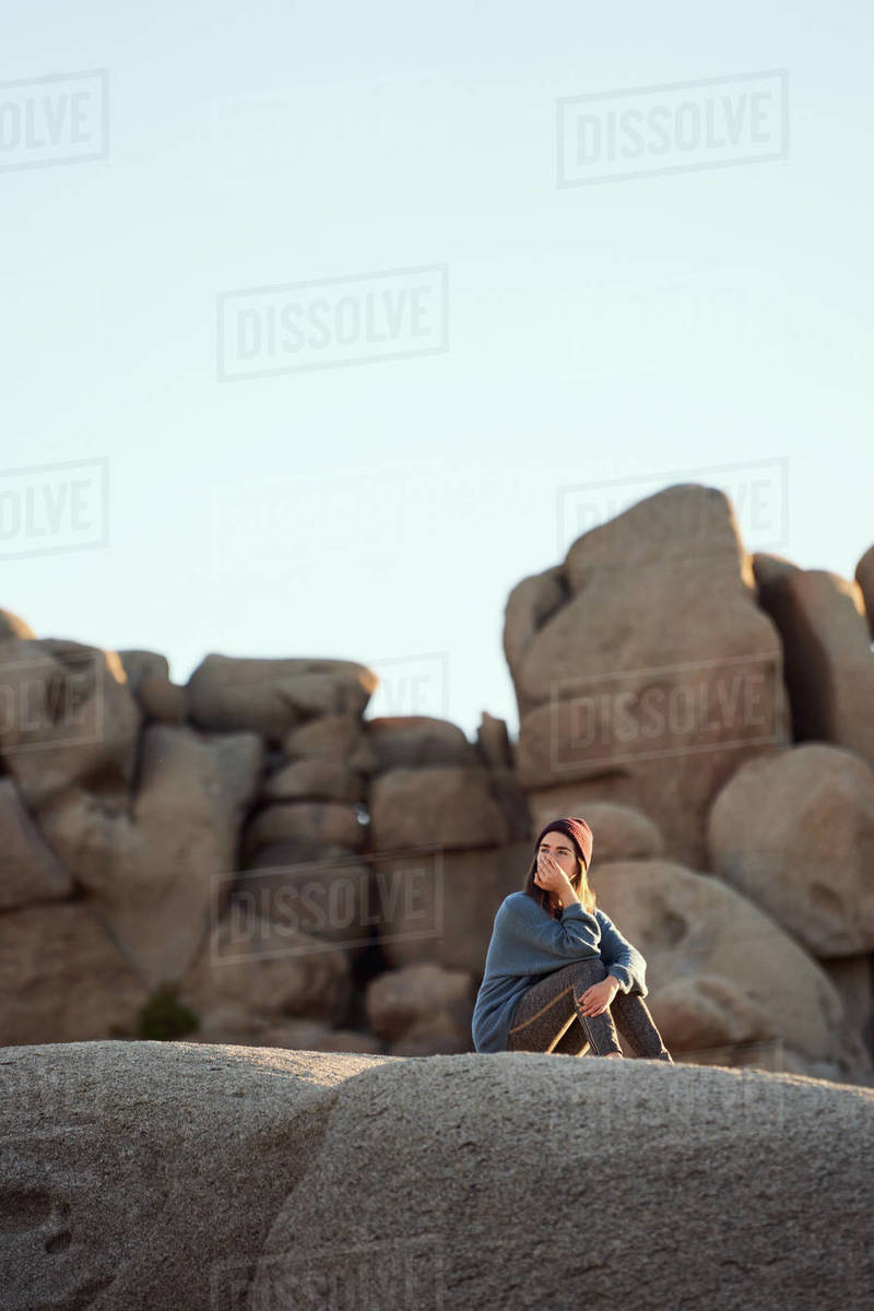 Young Woman Sitting on Rocks Contemplating Royalty-free stock photo