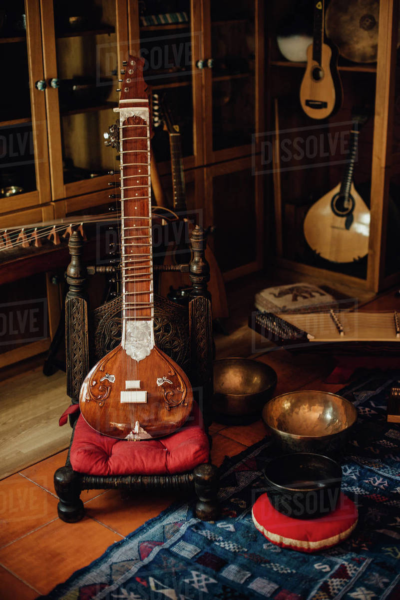 Traditional musical instruments, sitar, cimbalom, singing bowls Royalty-free stock photo