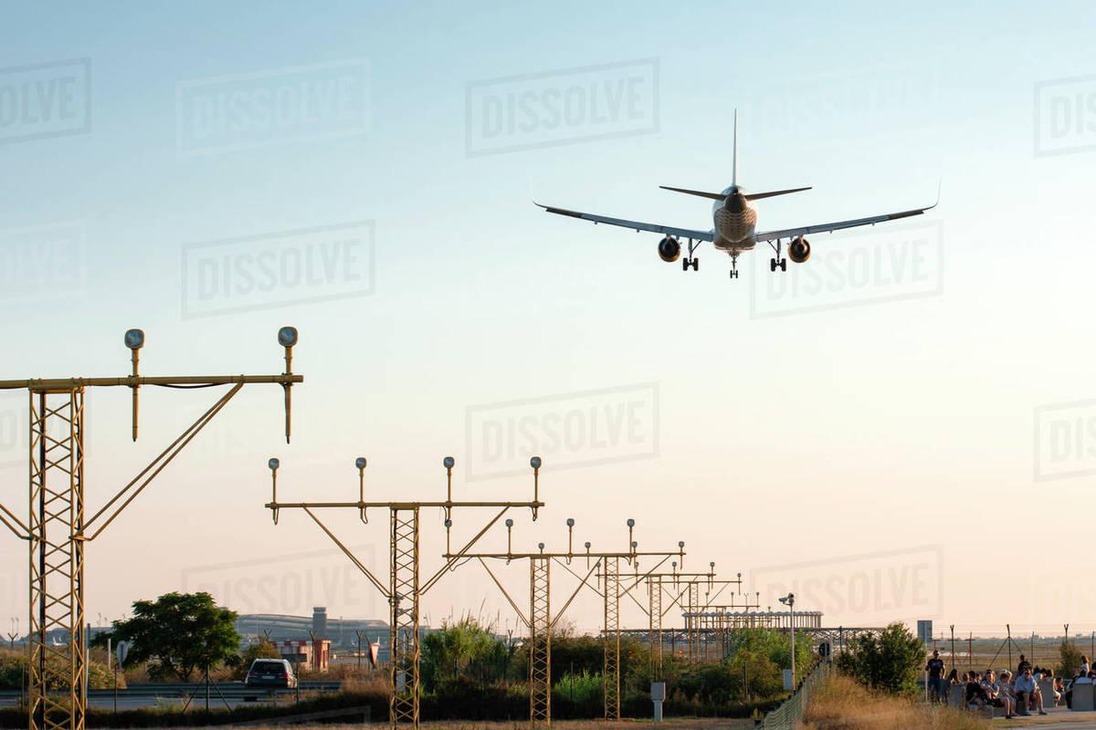 Airplane landing at sunset - image Royalty-free stock photo
