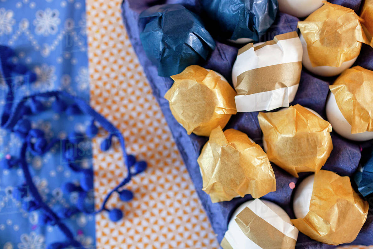 Closeup of decorated eggs with gold and white paper Royalty-free stock photo