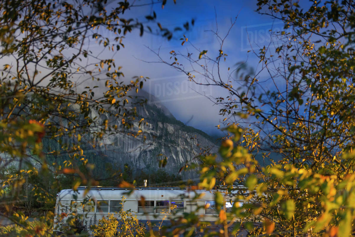 Converted school bus parked at night in front of mountain in Squamish Royalty-free stock photo