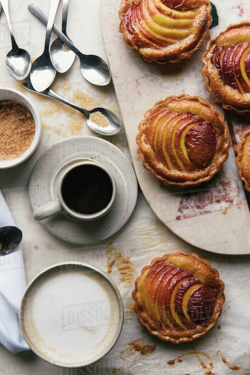Apple tarts, espresso and cappuccino at a breakfast cafe from overhead Royalty-free stock photo