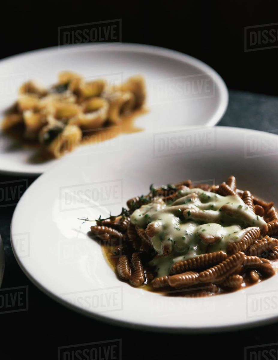 Freshly made pastas and herbs on a moody restaurant table Royalty-free stock photo