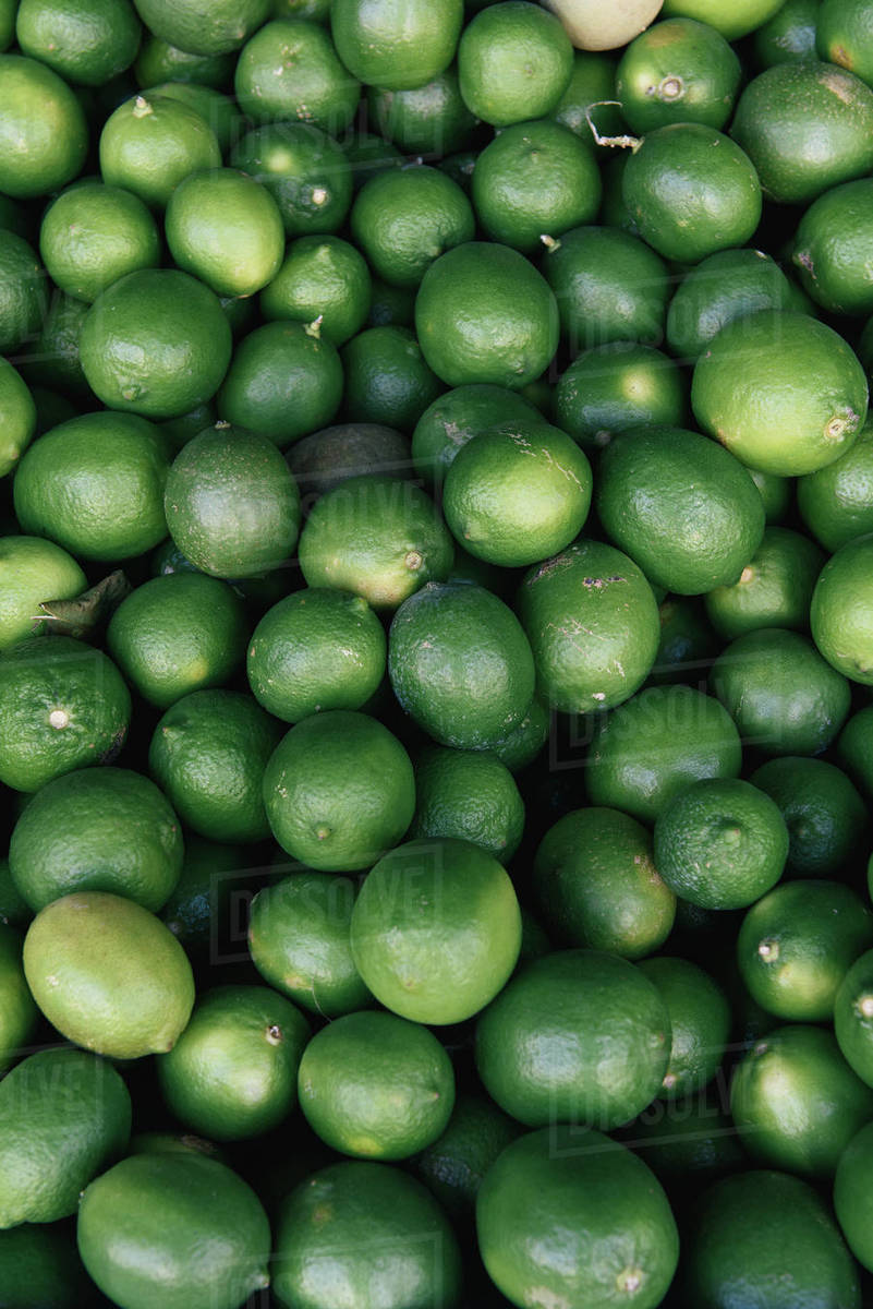 Bundle of organic lime at market stall Royalty-free stock photo
