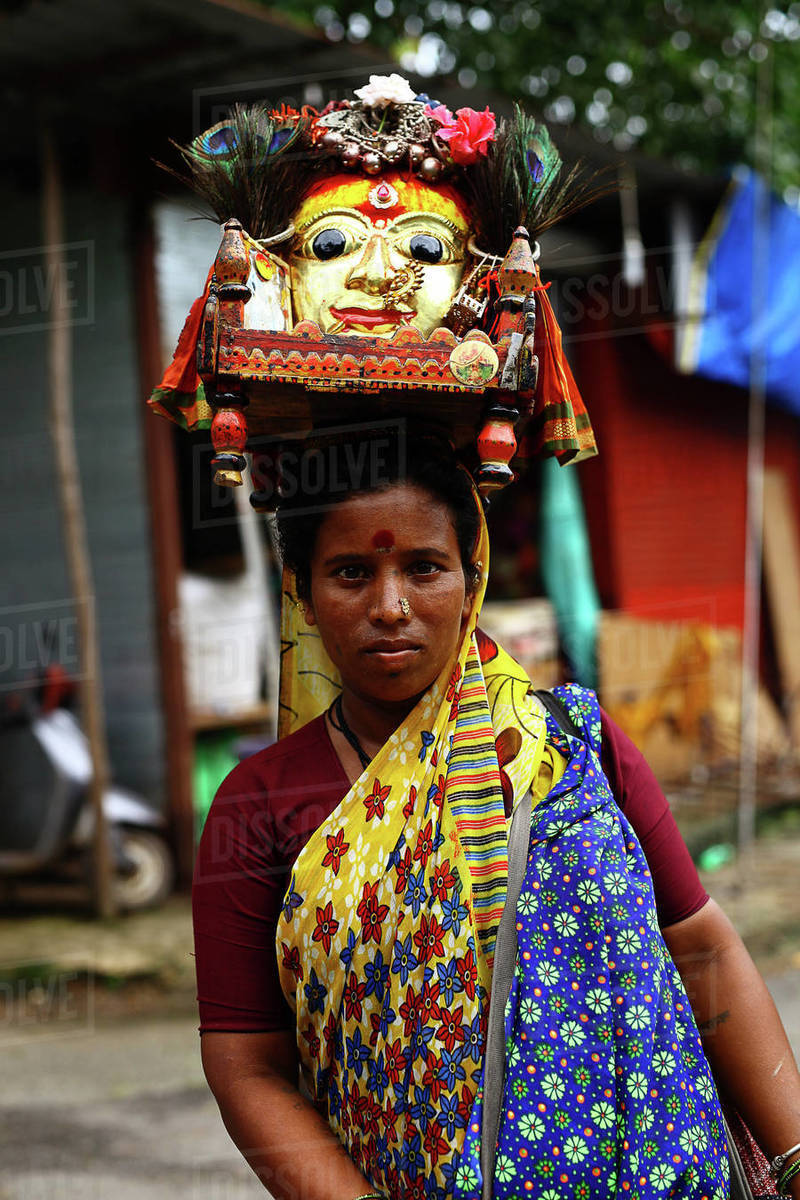 Indian woman carries altar on her head to put it in the temple.  Royalty-free stock photo