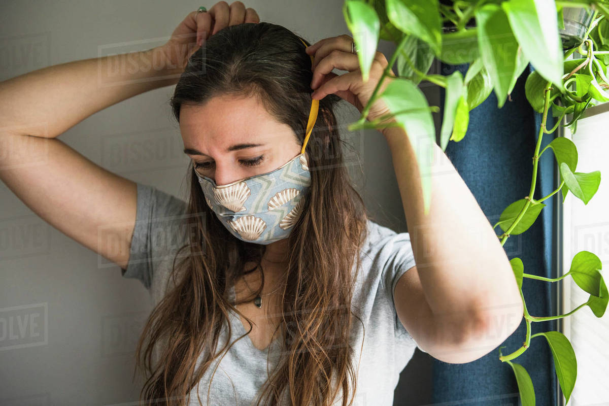 Woman indoors at home with homemade face mask protection PPE Royalty-free stock photo