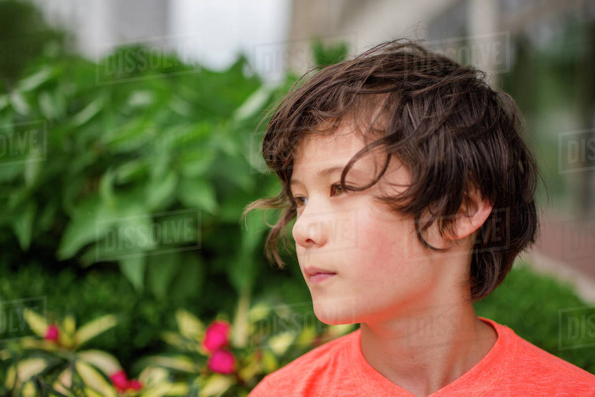 Close-up of a beautiful boy looking off with a serious expression Royalty-free stock photo