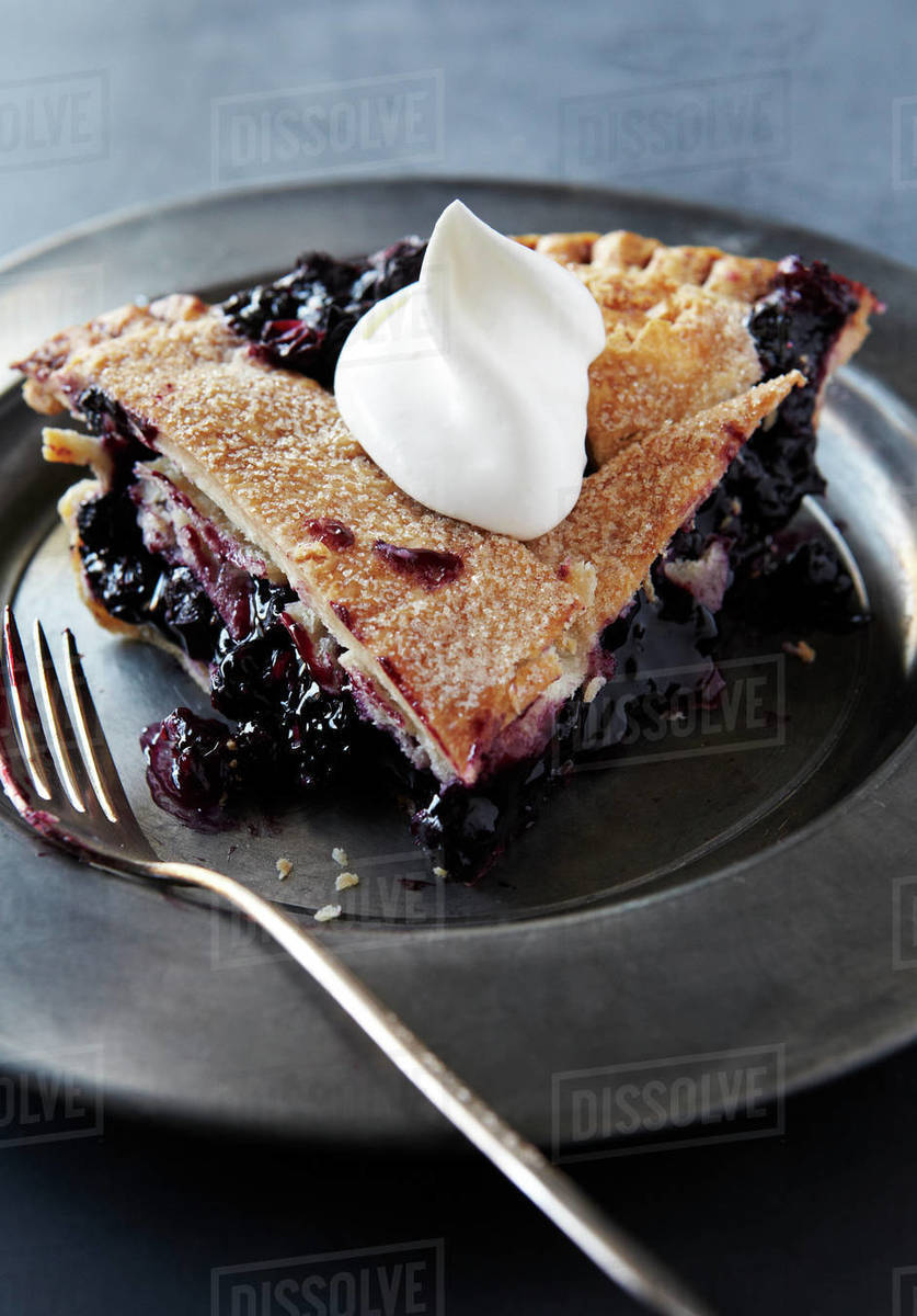 Slice of Blueberry Pie with Whip Cream Royalty-free stock photo