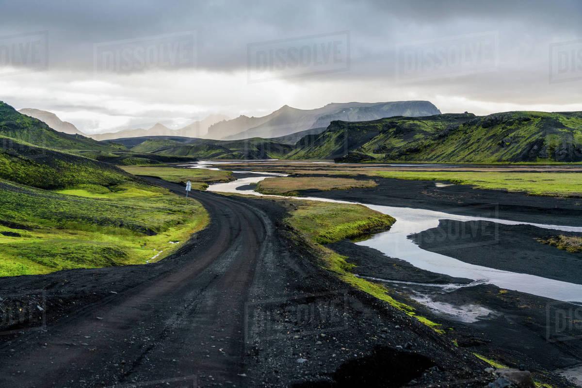 Black birthday road curve through Icelandic highlands landscape Royalty-free stock photo